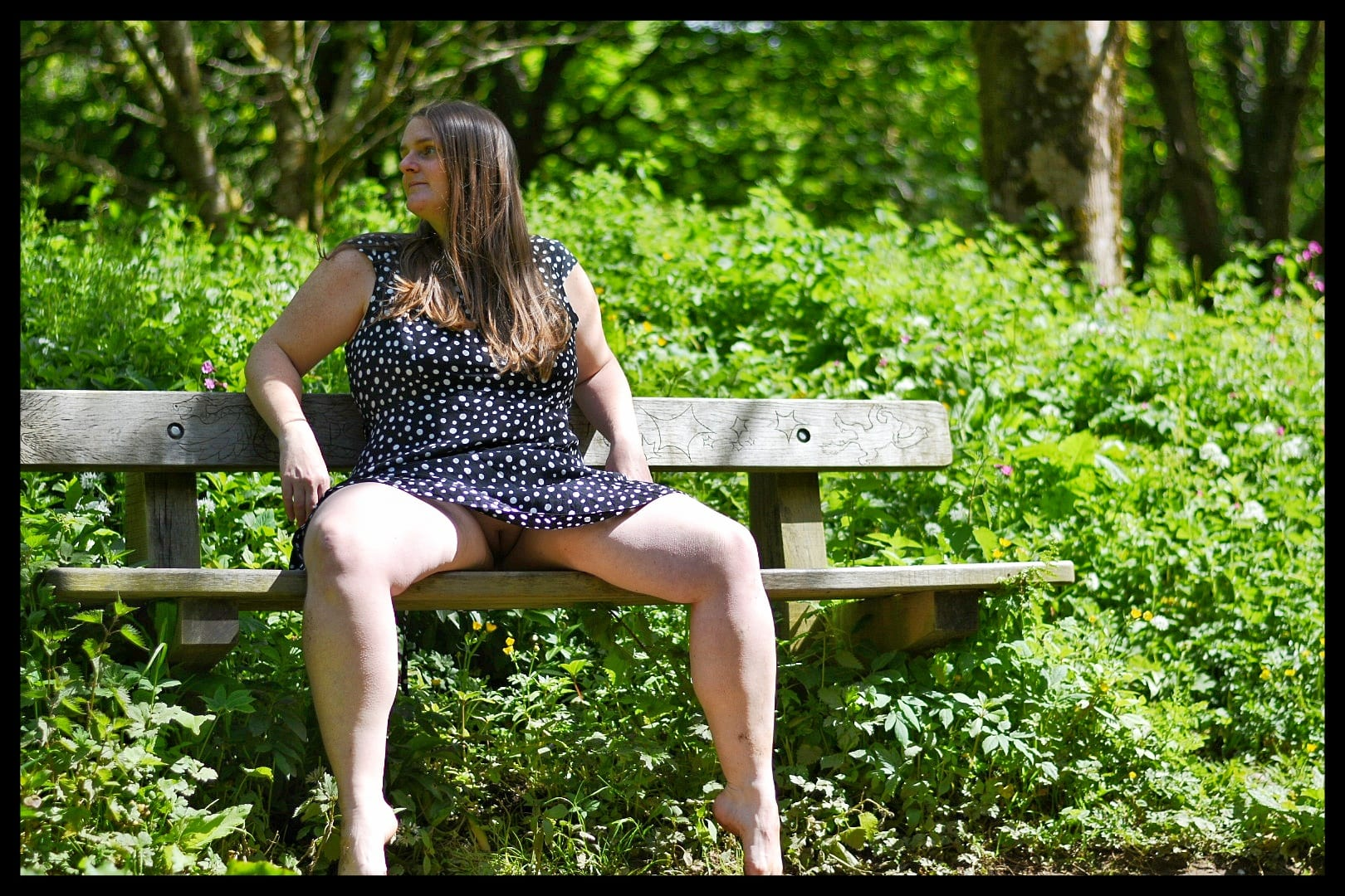 A barefoot girl on a bench.